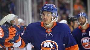 Islanders center Mathew Barzal (13) leads his team