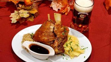 Crisp-skinned roasted Bavarian pork shank served with a