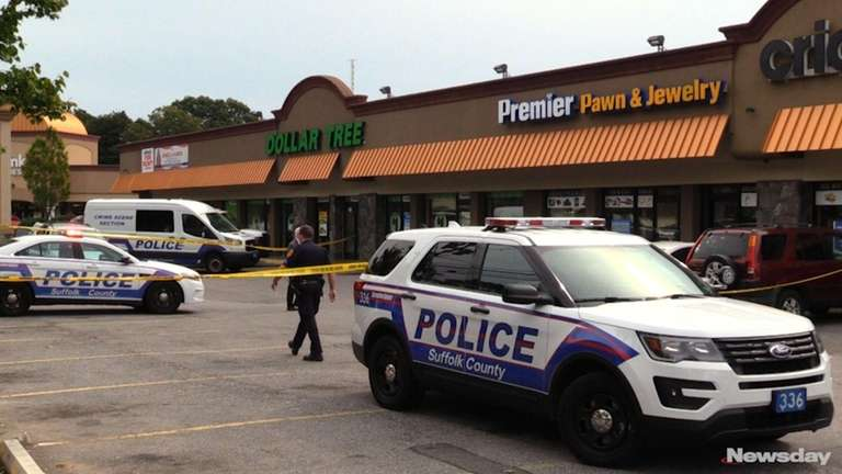 Police said two suspects walked into Premier Pawn