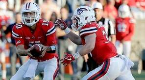 Stony Brook quarterback Joe Carbone (10) hands off