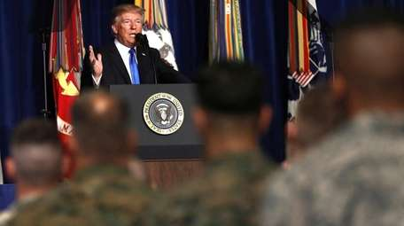 President Donald Trump talks about the U.S. troop