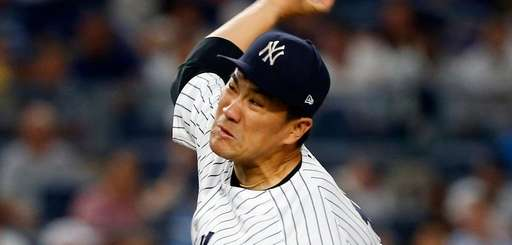 Yankees pitcher Masahiro Tanaka delivers against the Baltimore