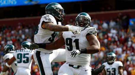 Eagles defensive tackle Fletcher Cox, right, celebrates with