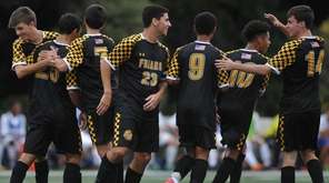 St. Anthony's teammates celebrate after a goal by