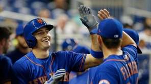 Mets' Brandon Nimmo celebrates with teammates after his