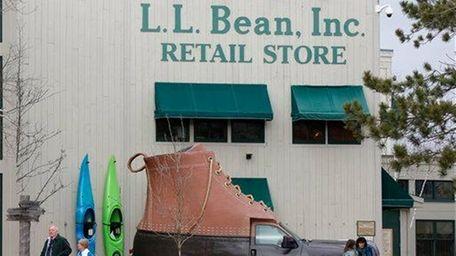 Shoppers walk outside the L.L. Bean retail store