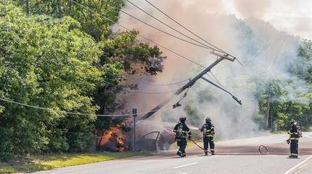 Firefighters at a crash on Moriches Middle Island