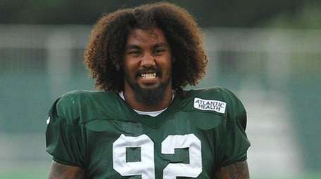 Leonard Williams of the Jets stretches during training