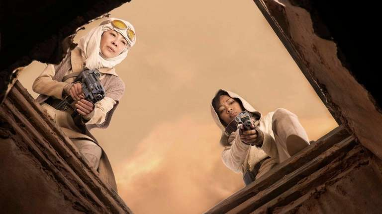 Michelle Yeoh, left, is captain Philippa Georgiou, and