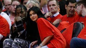 Houston rapper Travis Scott and Kylie Jenner watch