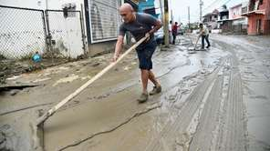 People clean the streets in Toa Baja, Puerto