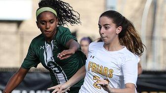 Holy Trinity's Mia Asenjo battles for ball possession