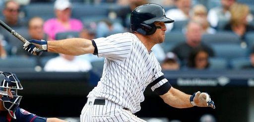 Yankees outfielder Brett Gardnerfollows through on anRBI single