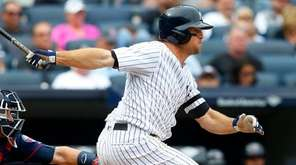 Yankees outfielder Brett Gardner follows through on an RBI single