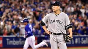 Yankees starter Masahiro Tanaka reacts after giving up