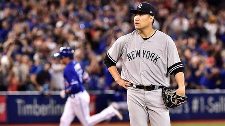 Yankees starter Masahiro Tanaka reacts after giving up