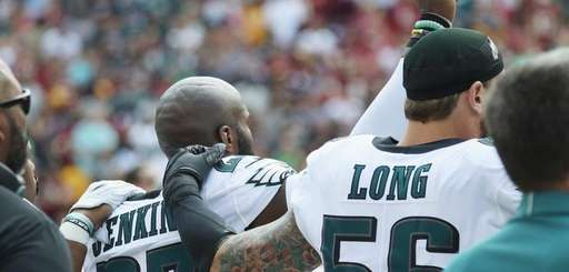 Eagles' Malcolm Jenkins and Chris Long react during
