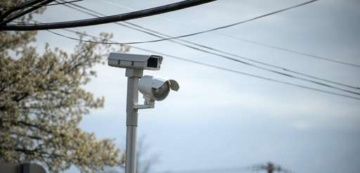 A red light camera at Indian Head Rd.