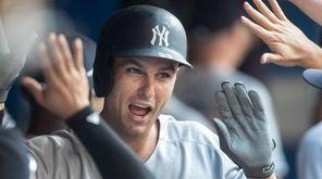 Yankees first basemanGreg Bird celebrates after hitting a