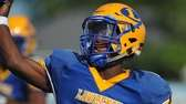 Lawrence quarterback Christian Fredericks #1 throws a pass