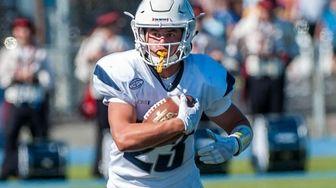 Oceanside's Derek Cruz (23) runs the ball during