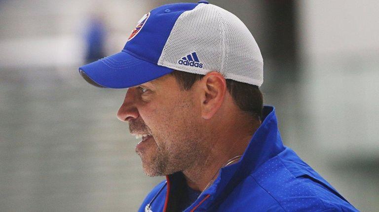 Islanders head coach Doug Weight looks on duringpractice
