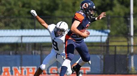 Steven Salerno #12 of of Manhasset runs the