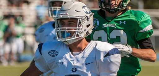 Oceanside's Jake Lazzaro runs for his first touchdown