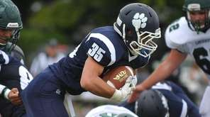 Justin Gerdvil #35 of Northport fights for yards