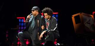 Stevie Wonder takes a knee