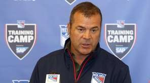 Rangers coach Alain Vigneault talks to the media
