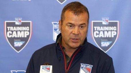 Rangers coach Alain Vigneault talks to the media