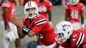 Stony Brook quarterback Joe Carbone calls for the snap at