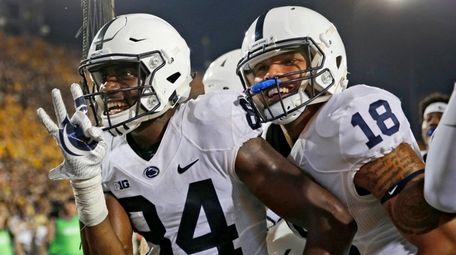 Penn State wide receiver Juwan Johnson, left, is