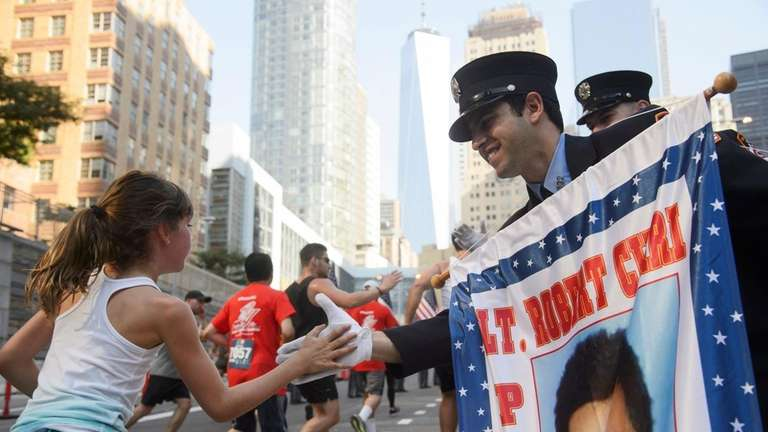 Runners are greeted by members of the FDNY