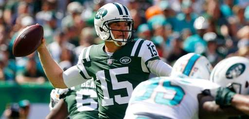 Josh McCown of the Jets throws a pass