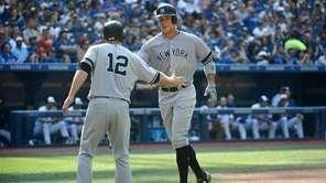 New York Yankees' Aaron Judge, right, celebrates at