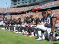 Members of the New England Patriots kneel during