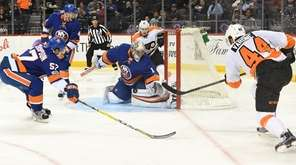 New York Islanders goalie Thomas Greiss defends the