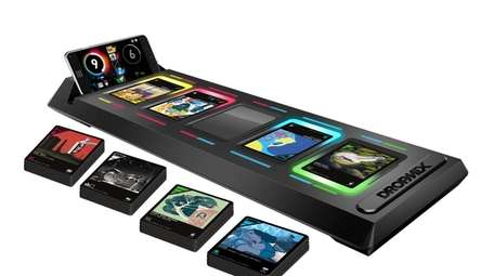 DropMix players use special cards, a gameboard and