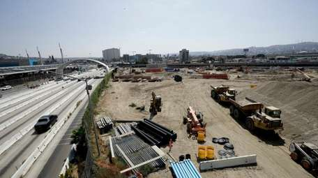 Cars move along California's Interstate 5 as construction