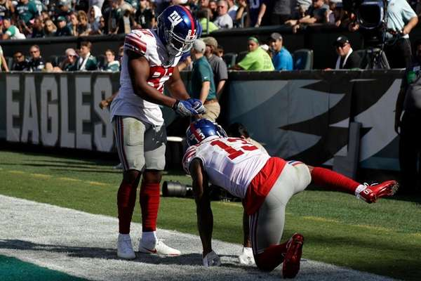 New York Giants' Odell Beckham, right, celebrates with