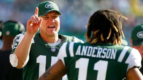 Josh McCown of the Jets stands on the
