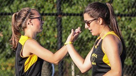 Commack's Emma Matz (left) congratulates doubles partner Julia