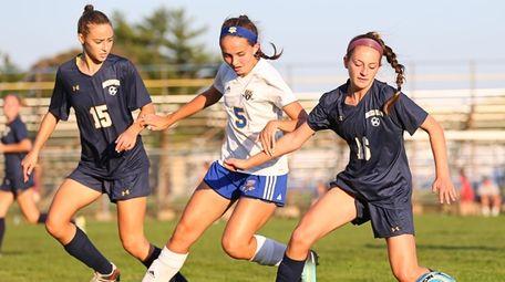Abby McAuley of Massapequa plays the ball against