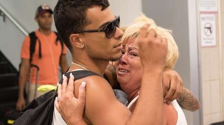 Joseph Roman 24, of Levittown, gets a hug