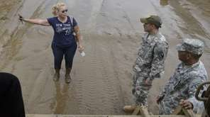 National Guard personnel offer evacuation to a Toa