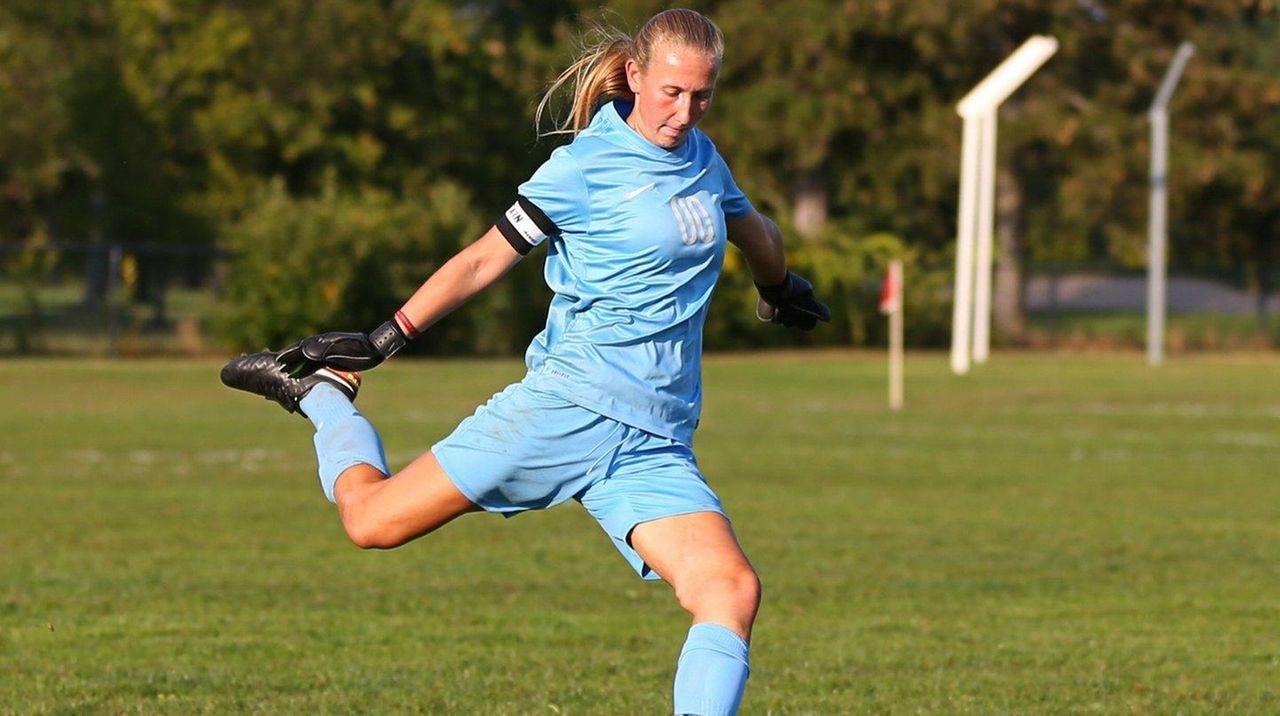 Stephanie Sparkowskiof East Meadow plays the ball against