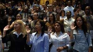 New US citizens taking the oath.