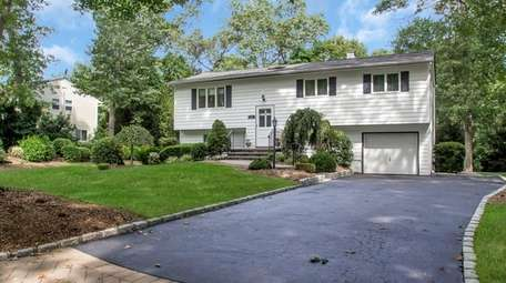 This Commack high-ranch, listed for $499,000, includes six
